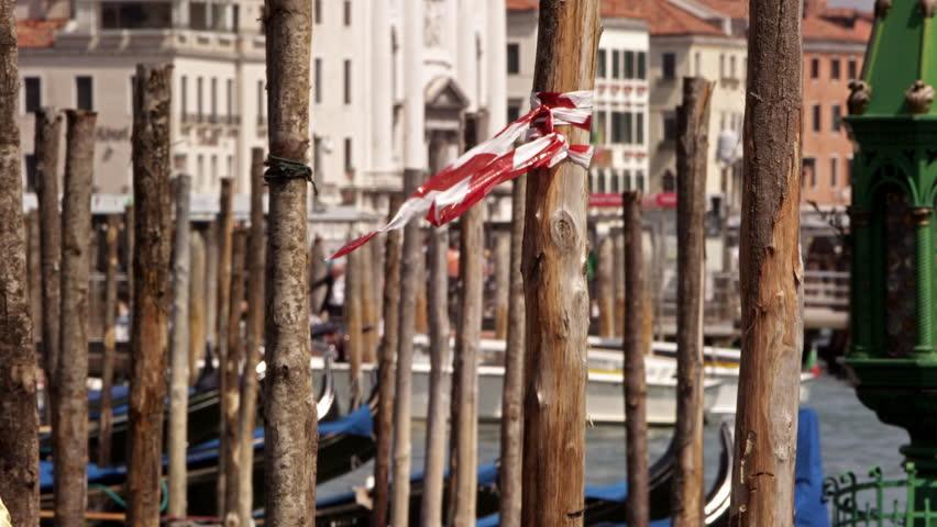 Slow motion shot of wooden docking posts for gondolas
