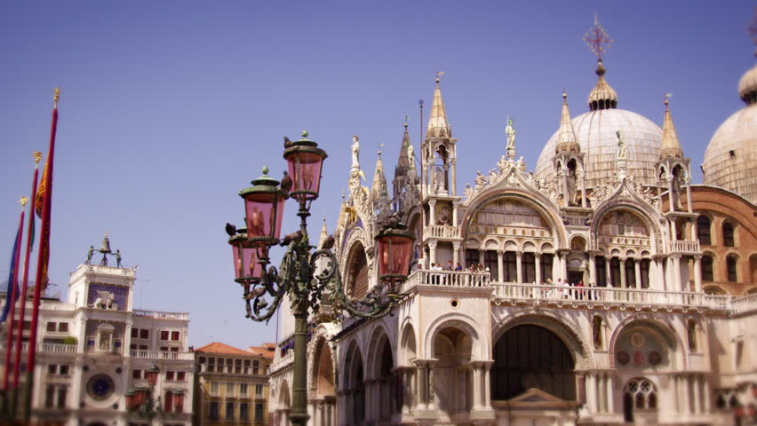 Slow motion, panning shot of Basilica San Marco