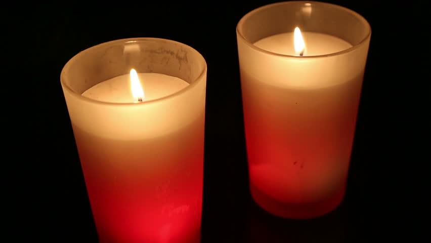 Time Lapse Footage Of A Pair Of Candles Burning On A Dark ...