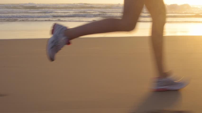 Running woman outdoors beach run
