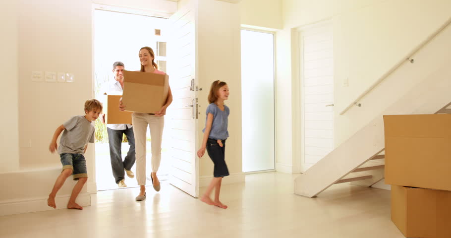 Happy family moving into their new home in their new home