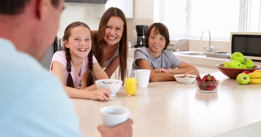 happy family having dinner together at home in the kitchen stock, Kitchen design