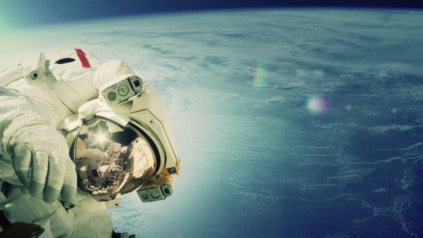 Astronaut taking a spacewalk. Extreme closeup in 4K