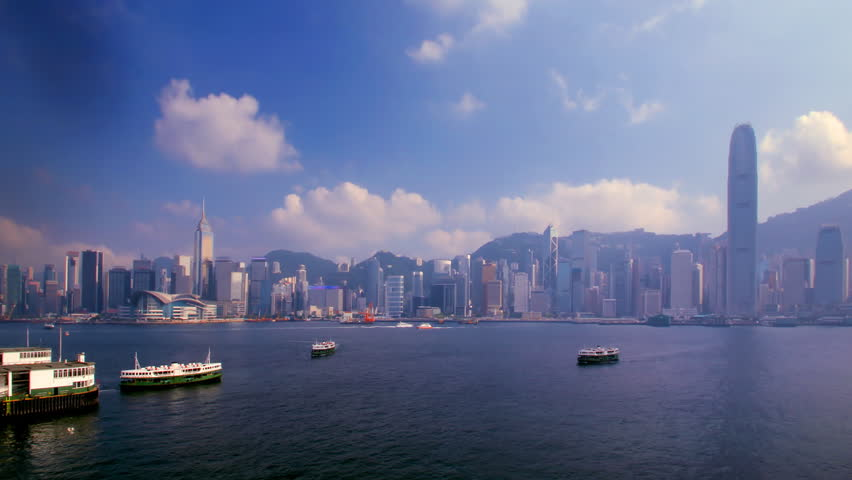 Daytime time-lapse of the Hong Kong skyline, depicting Victoria Harbour with Central and Wan Chai skyscrapers in the background and the Star Ferry pier and ships cruising the harbour on the foreground | Shutterstock HD Video #6039104