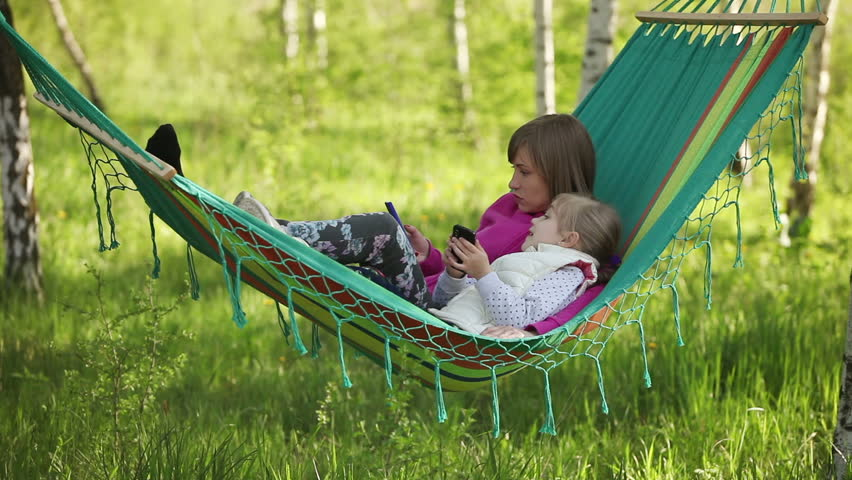 lying in a hammock The video clip cute child girl lying on hammock and relax at the sandy beach in slow motion from alexeg84 is available on fotolia under a royalty-free license from.