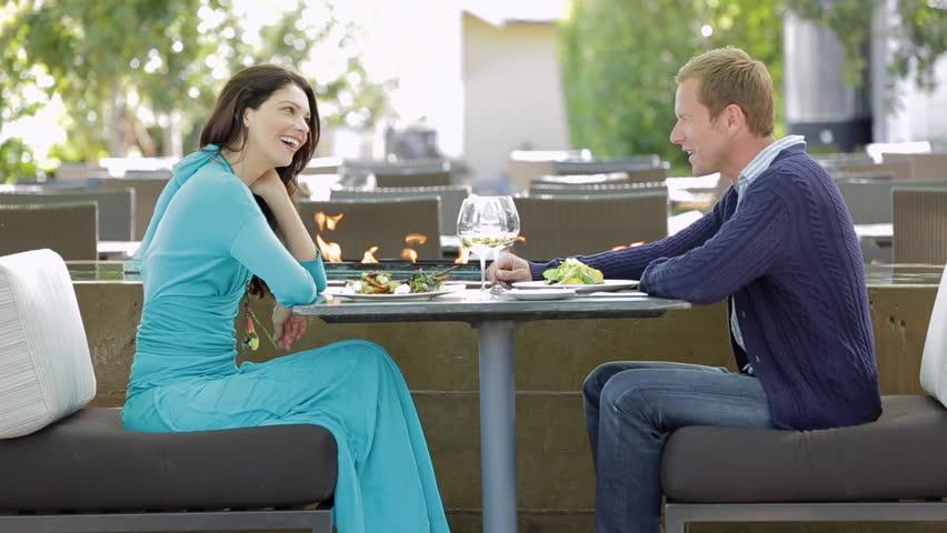 Couple enjoying a gourmet dinner outdoors at a luxury resort | Shutterstock HD Video #6216311