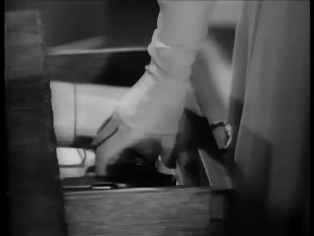 Close-up of woman's hand taking handgun out of top drawer | Shutterstock HD Video #6275333