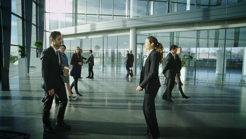 Business people meet and shake hands in large modern office building | Shutterstock HD Video #6284825