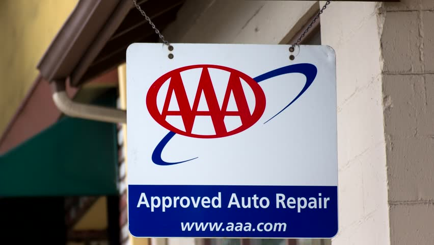MONTEREY, CA/USA - MAY 23, 2014: AAA Sign in front of auto repair garage. The  AAA is a non-profit federation of motor clubs in North America.