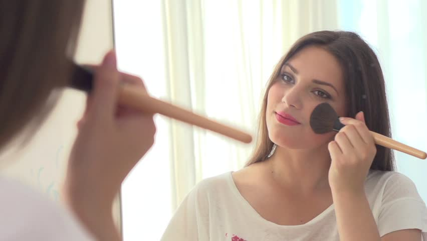Image result for woman applying makeup