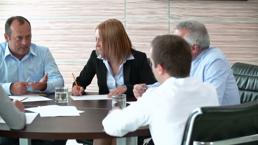 Pan of business people brainstorming at round table | Shutterstock HD Video #6696374