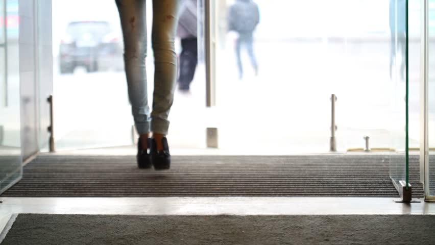 Girl Walks Into Door : Woman leaving car open walks away stock footage video