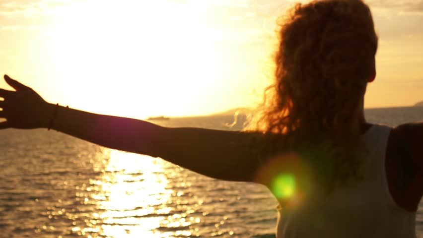 Young Happy Girl with Curly Hair and Tatto Spreading Arms at Beautiful Sunset. Sailing on the Ferry. Motivating Inspiring Slow Motion Video. | Shutterstock HD Video #6778219