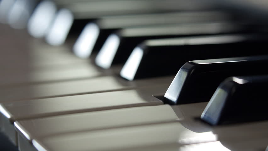 Fingers close up on piano keys