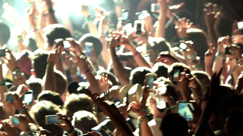 Crowd at Concert - Fans Cheering in Audience with Smartphones in Music Show at Coachella in Slow Motion   Shutterstock HD Video #6956665
