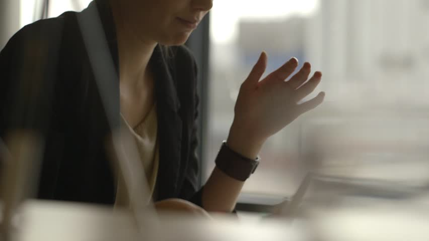 Bored female employee at work. Sitting at her desk dreaming for more. Playing with her pencil out of shear boredom | Shutterstock HD Video #7090837