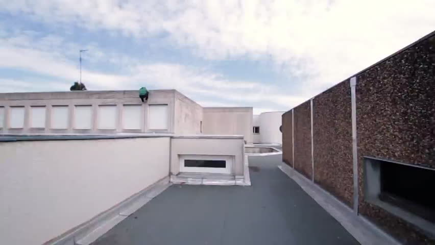 A traceur successfully performs a jump on the roof of a building