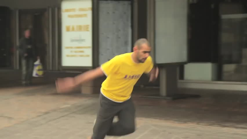 A traceur successfully performs cartwheel backflips
