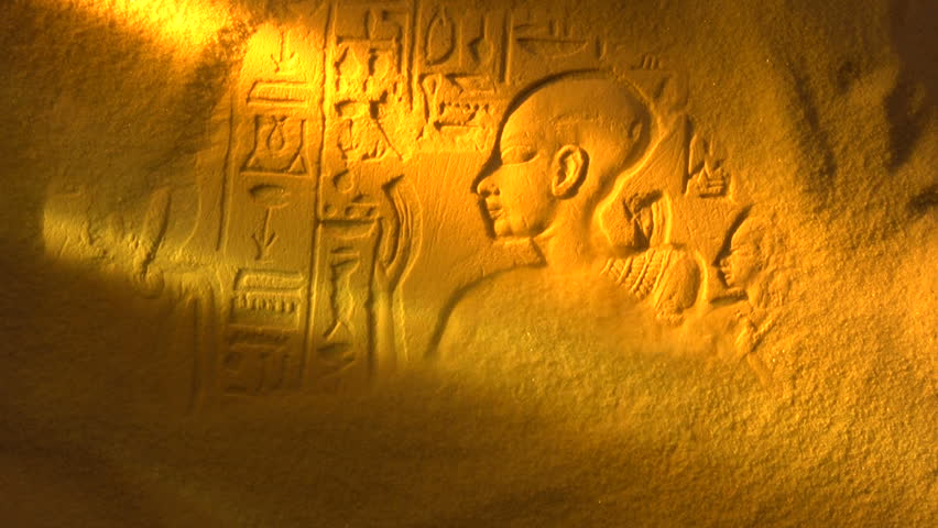 Desert sand blows away to reveal ancient Egyptian Hieroglyph, shot in studio NOT