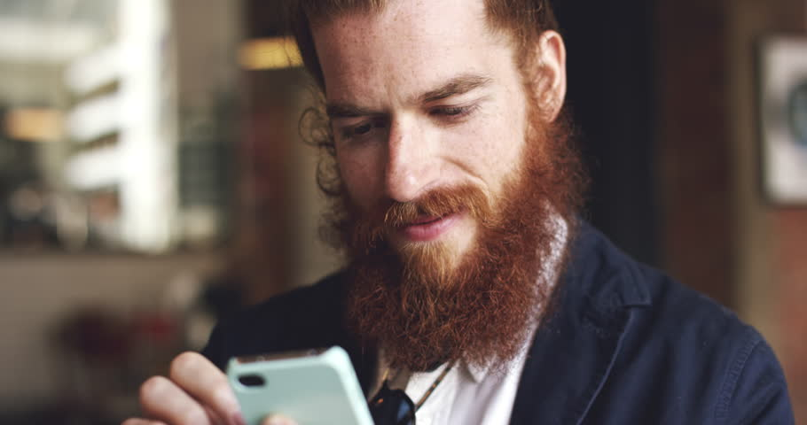 Man using mobile phone in cafe is happy hipster - RED DRAGON   Shutterstock HD Video #7358527