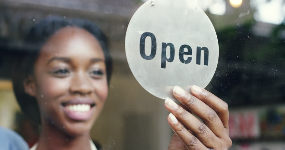 Small business owner turning over open sign   Shutterstock Video #7374598