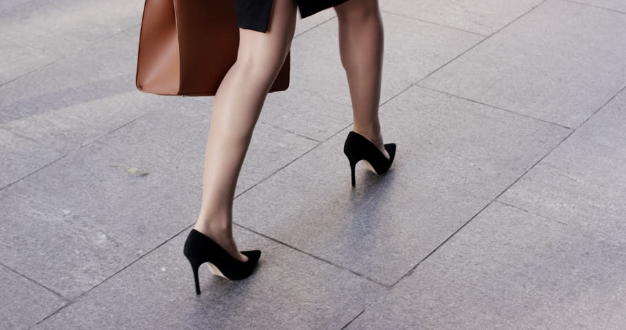 Sexy legs black high heels walking in city urban street - RED EPIC DRAGON 6K | Shutterstock HD Video #7391329