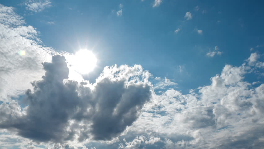 Spectacular sun bursting through clouds beautiful sky timelapse 4K UHD Sun bursts through clouds forming and dissolving across a blue sky. | Shutterstock HD Video #7401367
