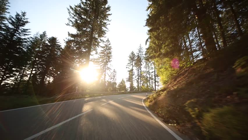Video footage of driving on a country road in the black forest in germany