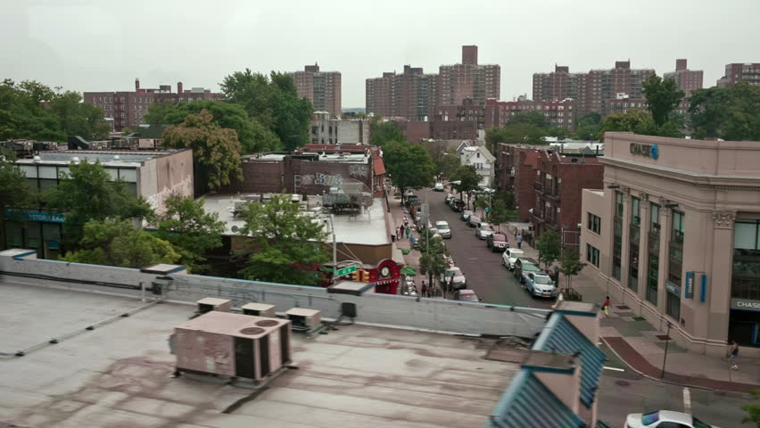 NEW YORK - JULY 14, 2014: Queens viewed from moving MTA subway in New York. Queens is the easternmost and largest of the five New York City boroughs, adjacent to the borough of Brooklyn.