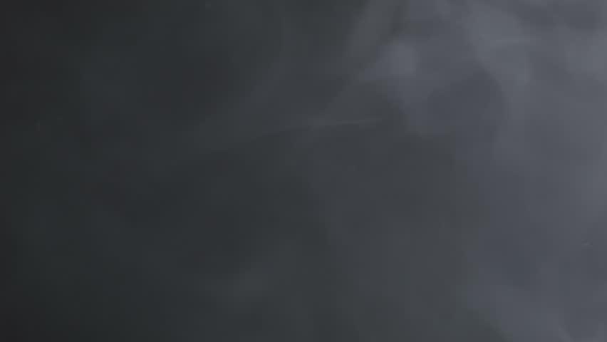 Veil of smoke floating in space, black background | Shutterstock HD Video #7616935