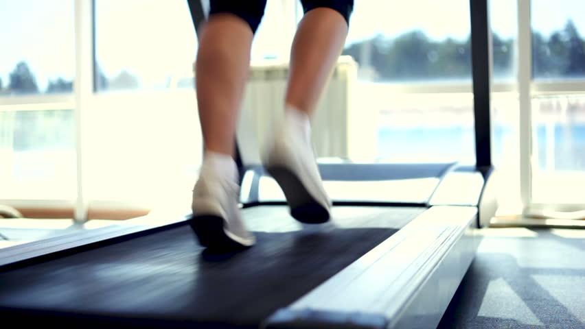 Woman running on a treadmill. Close-up shot/Running on a Treadmill   Shutterstock HD Video #7773175