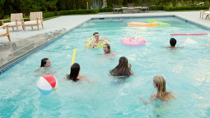 Teen friends have a fun chicken fight at a pool party for Chicken swimming pool