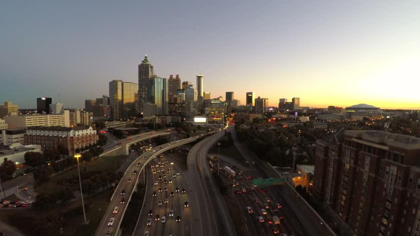 Atlanta cityscape aerial flying over freeway...