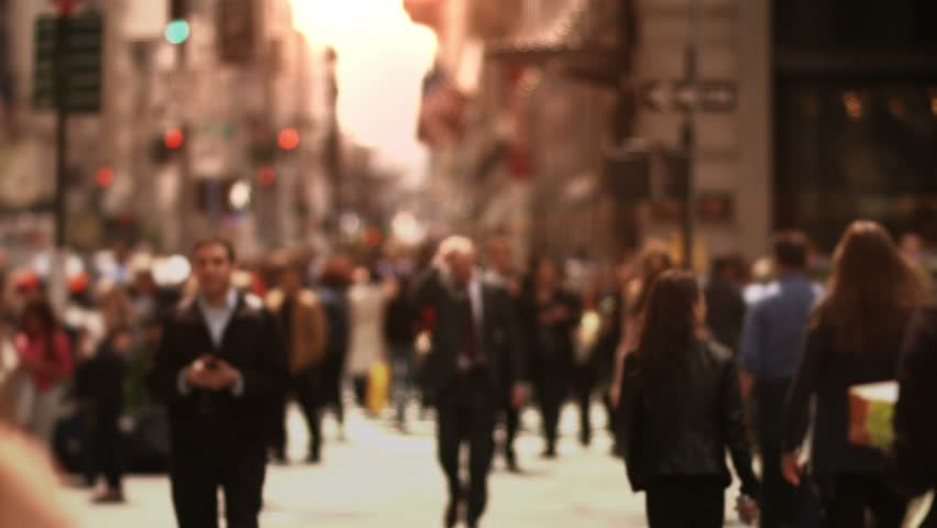 Large crowd of people walking in a big city...