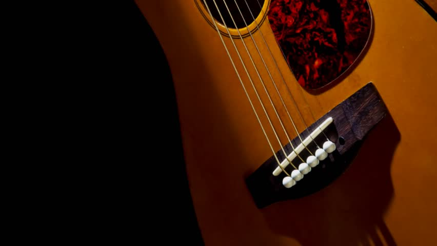 Tilt up in an accoustic guitars beautifully illuminated