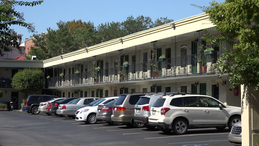CHARLESTON, SOUTH CAROLINA/USA - OCTOBER 21, 2014: Cars parked at Days Inn motel. Days Inns Worldwide, Inc. is a hotel chain headquartered in the United States and was founded in 1970.