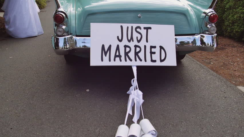 Just Married Car with Cans in Slow Motion