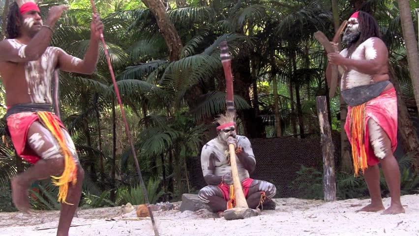 Yugambeh Aboriginal warriors men sing play and dance during Aboriginal culture show in Queensland, Australia.