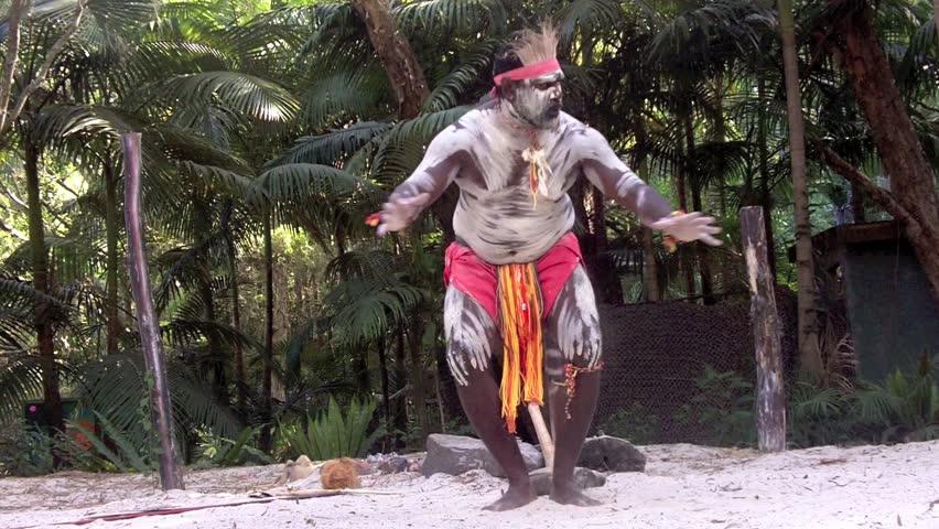 Yugambeh Aboriginal warrior man dance during Aboriginal culture show in Queensland, Australia.