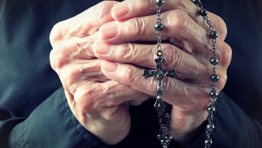 Image result for hands holding rosary