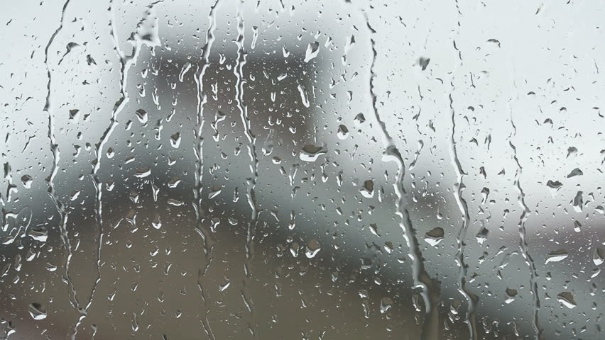 Delighful Raindrops Falling From The Sky Image Of Rain Drops On A Window Out Focus With Decor