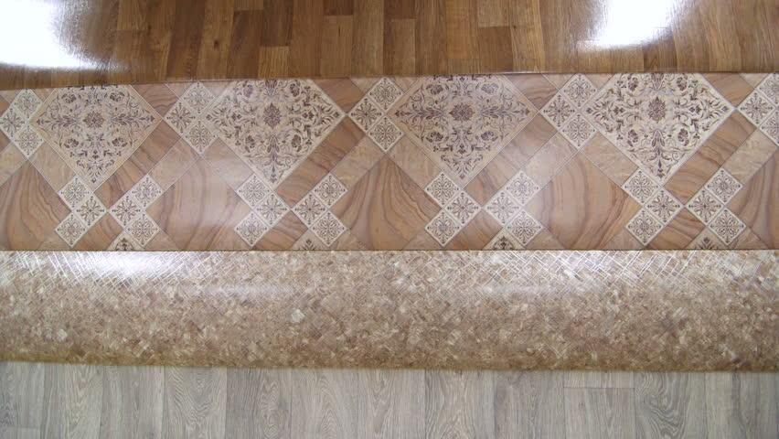 variety of linoleum rolls in flooring warehouse stock footage