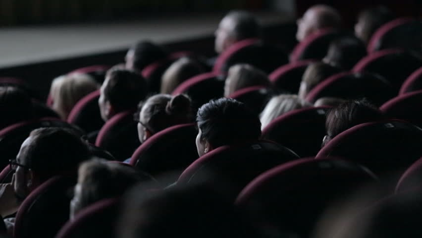 Spectators people in a dark movie theater watching a movie | Shutterstock HD Video #8559817