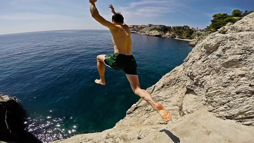 Athletic Young Man Jumping From Cliff Into Ocean Sea Water Muscular Adventure Extreme Sports Lifestyle Hobby Vacation Clear Beach Slow Motion Leisure Activity Gopro HD | Shutterstock Video #8623765