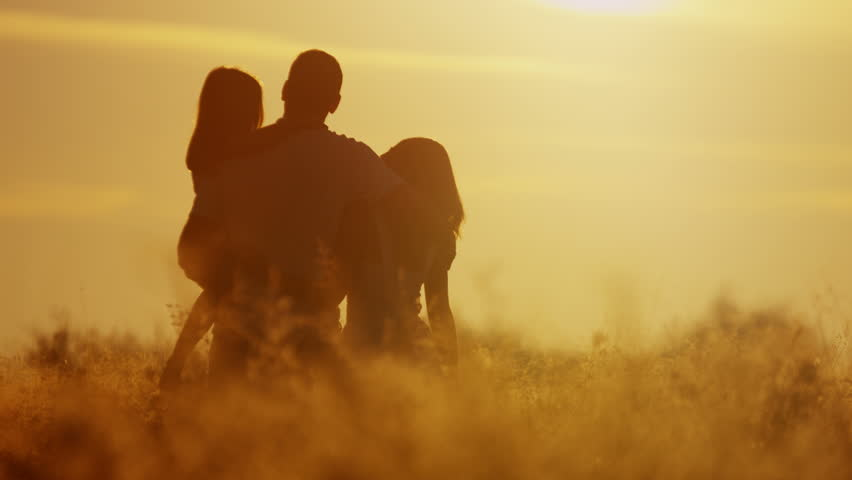 Young loving carefree Caucasian family parent young daughter outdoor sunrise field fun childhood innocence happiness together RED EPIC | Shutterstock HD Video #8672242