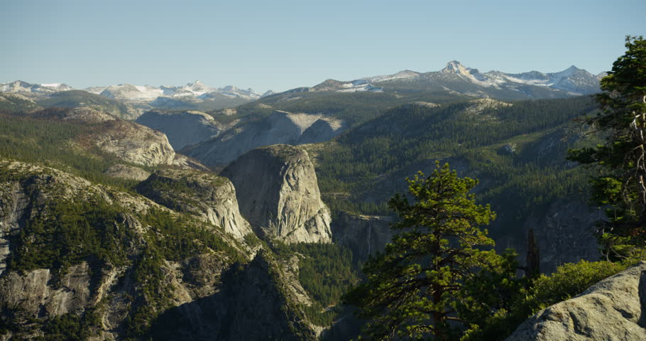 Yosemite Valley can be seen from Glacier Viewpoint during noon. Yosemite National Park, California is visited by over 3.7 million tourists yearly. Shot on Red Epic.