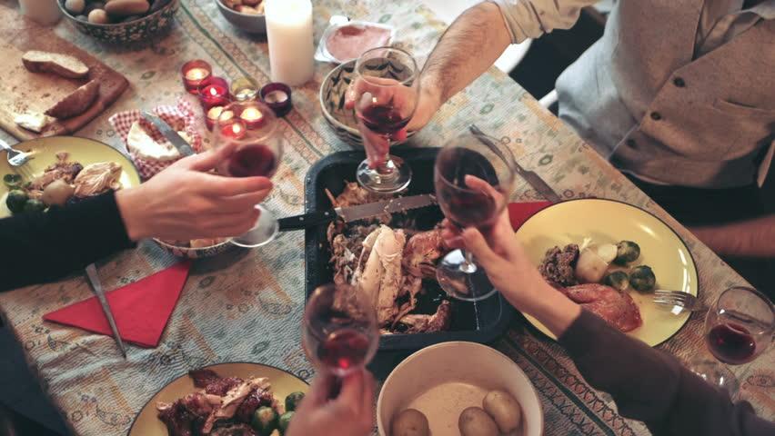 Friends enjoying wine at Christmas dinner | Shutterstock HD Video #8685979
