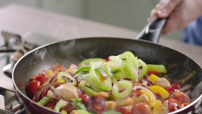 Frying vegetables and chicken white meat.  | Shutterstock HD Video #8773273