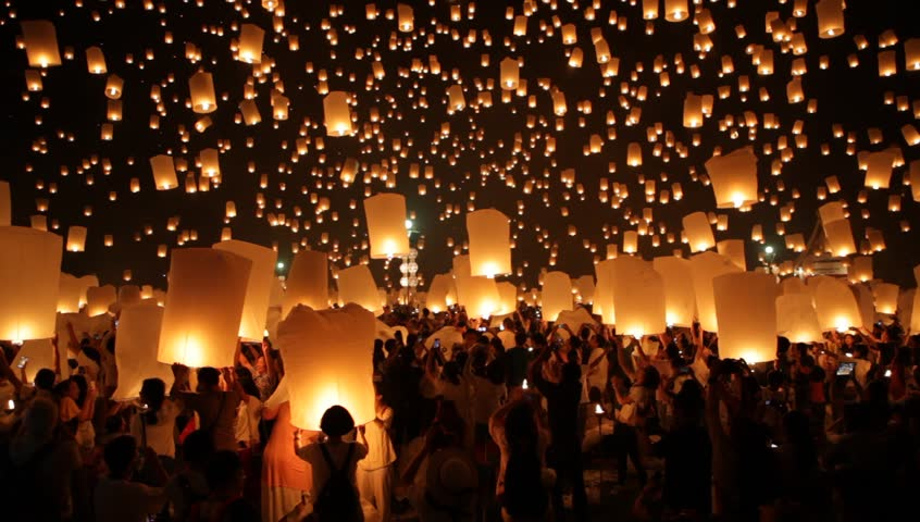 CHIANG MAI, THAILAND - OCTOBER 25, 2014:  Loy Krathong celebration, people release thousands floating lanterns, during Yi Peng festival in Chiang Mai near Mae Jo University. | Shutterstock HD Video #8947228