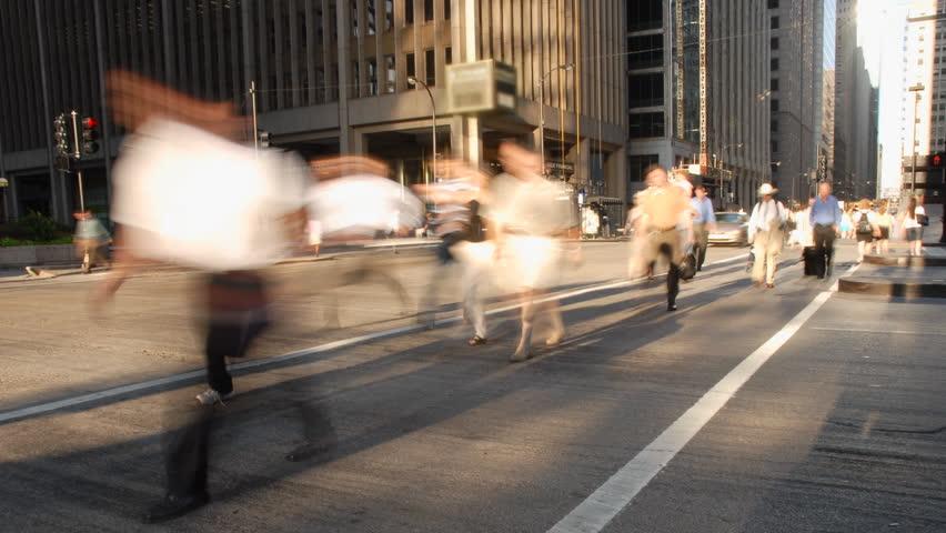 City commuters at crosswalk in rush hour